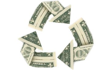 Dollar bills arranged in the recycle symbol