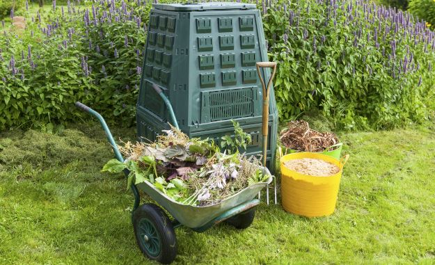 Composting barrel, wheelbarrow, and garden