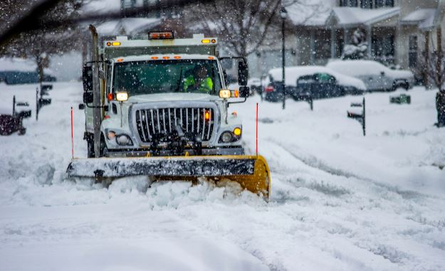 Snow plow in a blizzard